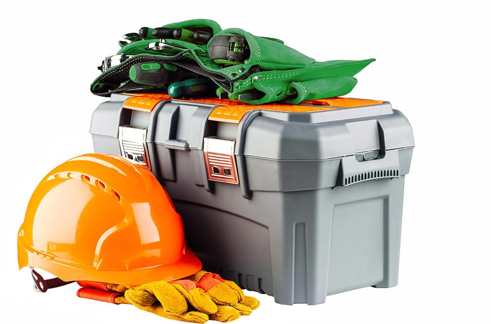 grey toolbox with orange helmet and yellow gloves